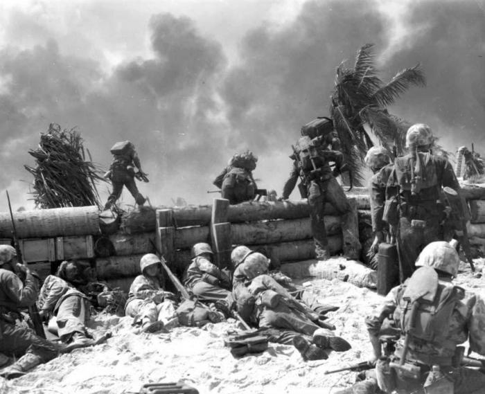 Marines advancing over the seawall.