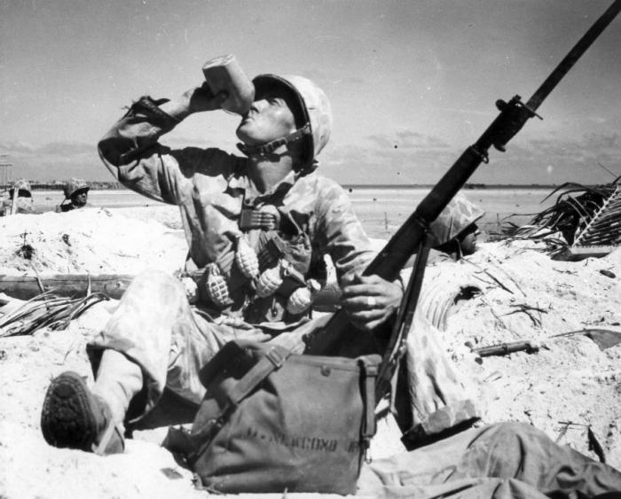 A Marine takes a drink during a lull in the fighting.