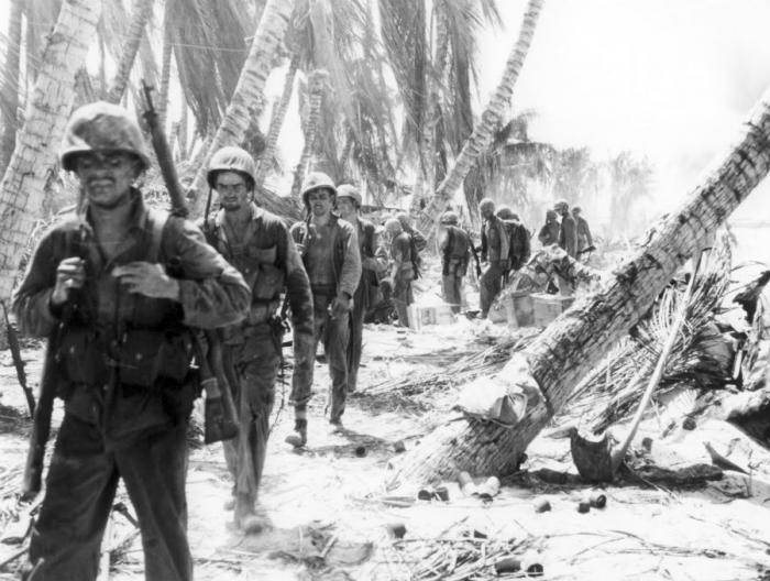 Marines marching inland during the second day of fighting.