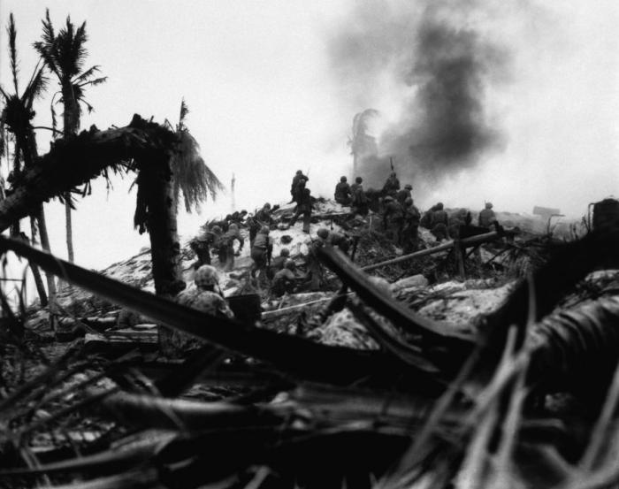 Marines destroy a Japanese bunker with explosives.