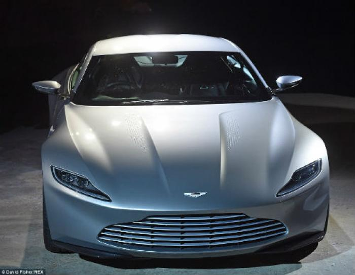 The sleek new Aston Martin DB10 was also unveiled at the official photocall and will be the car of c