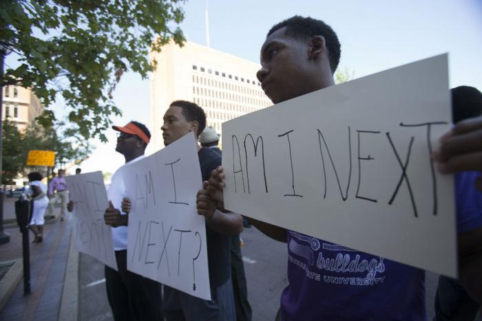 As negative outlooks on racial relations reach a new high, protests surrounding the Ferguson and Sta