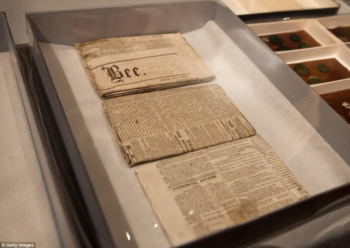 Five folded newspapers were found in the time capsule. They will likely remain folded to preserve th