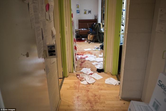 The chilling image from the Charlie Hebdo office shows blood-stained wooden floors, papers strewn ac