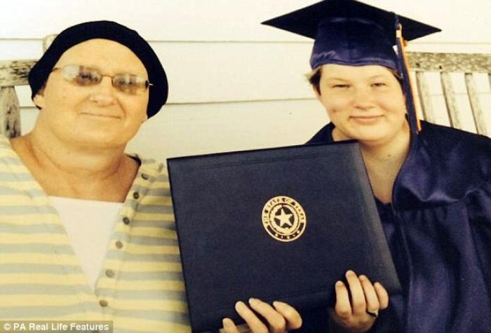 In her cap and gown, Lauren stands with her mother Sabrina Kavanaugh.